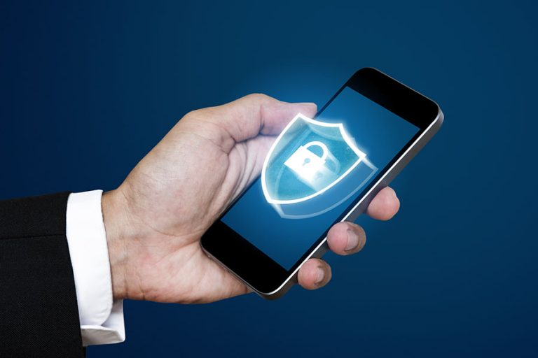 Businessman using mobile smart phone with lock icon on screen
