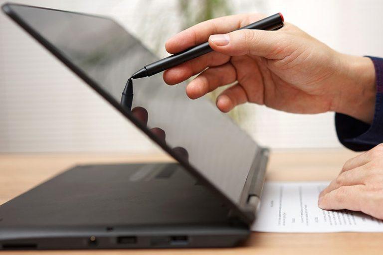 Student Using a Touchscreen Laptop Computer