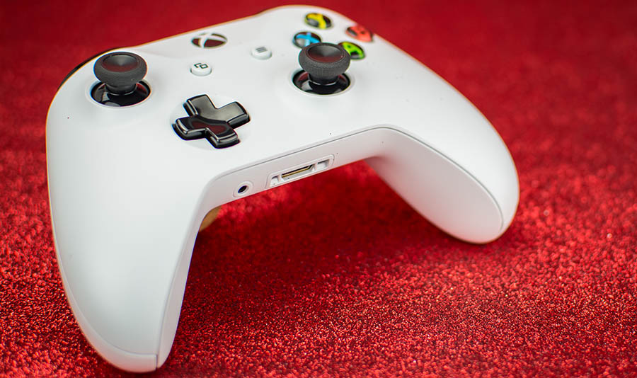 Xbox One Controller in Front of Red Background
