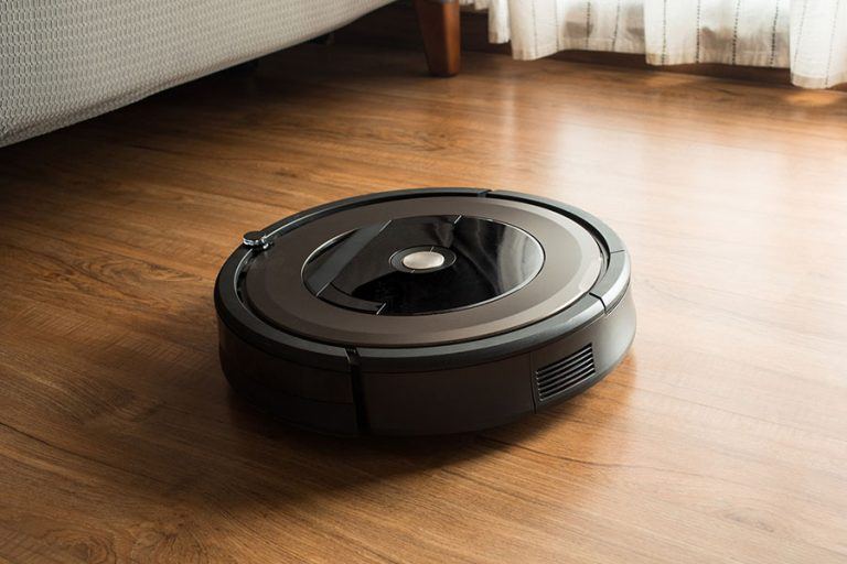 Robot vacuum cleaner on wood, laminate floor