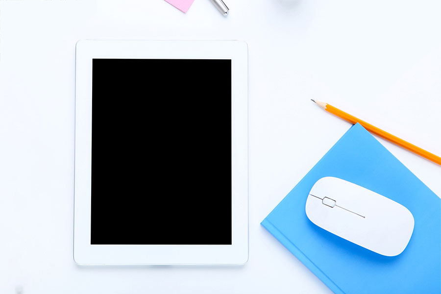 Tablet with Mouse, Pens, and other school supplies