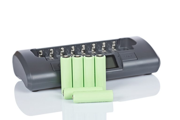 green rechargeable batteries with a charger