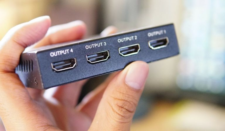 Person holding an HDMI Splitter